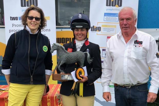 Kitty King (centre) celebrates her win at the Nunney International Horse Trials