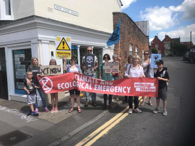Climate change protesters outside Claire Perry's offife in Devizes