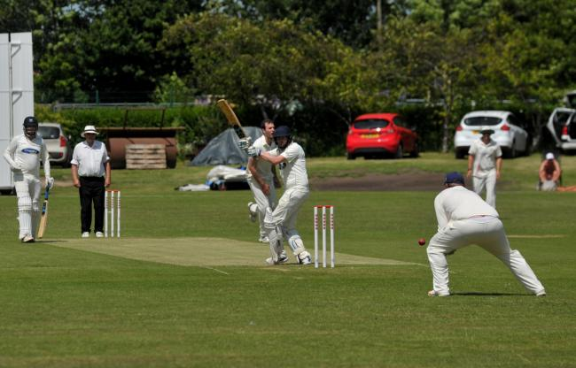 This Westbury & District batsman is unable to get bat on ball during Saturday's defeat at Swindon  	           Picture: Dave Cox