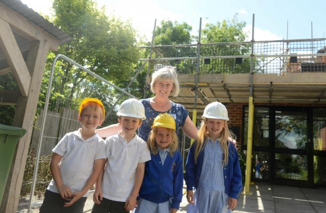 Head teacher Carol Talbot with some pupils at Urchfont Primary, where building work can now start on improvements                      Photo: Siobhan Boyle SMB2772/1