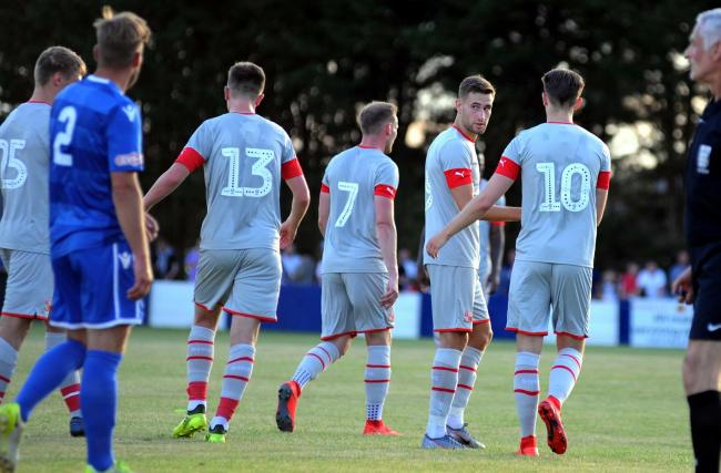 Trialist Will Randall checks back over his shoulder after scoring the opening goal for Swindon Town during last night's 3-0 win away at Swindon Supermarine in a pre-season friendly. Randall spent his youth career at Town before leaving the club in 2