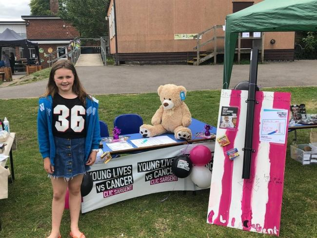Poppy with her CLIC fundraising stall