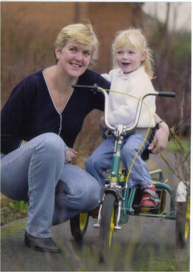 Lauren Booth (right) with mother Lisa Jayne Booth, enjoying the trike given by Meningitis Now
