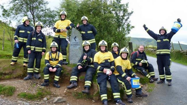 The Corsham firefighters pictured at the start of their Snowdon climb last year