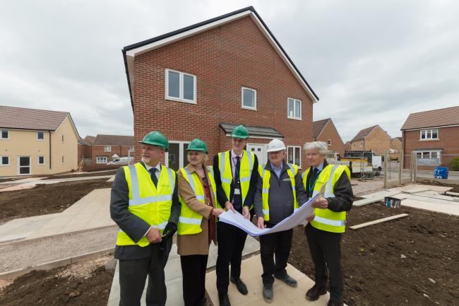 Wiltshire Council officers on site of phase one of council housing in Trowbridge and cuncillors Tim Bruce and Janet O'Brien, Cllr Clewer, site manager Tom Duggan and Cllr Peter Fuller at Southview Close, Trowbridge