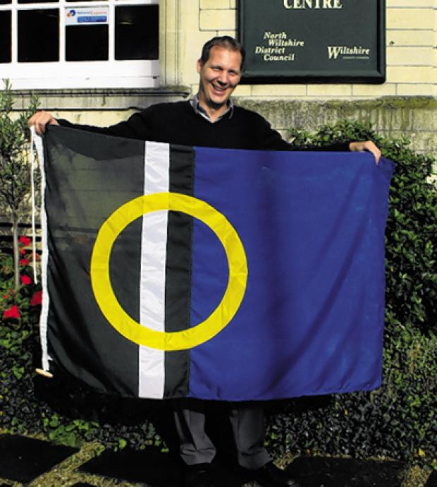 Kevin Hatchman with his winning flag design