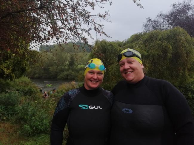 Laura White and Georgie Price swimming the River Wye