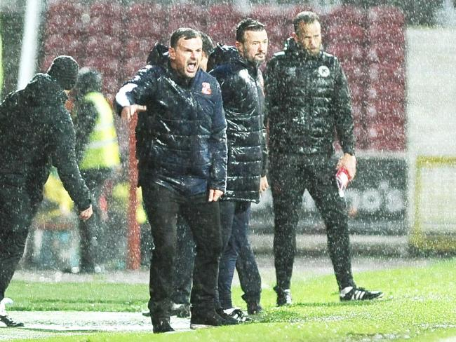 Richie Wellens is braced to face Scunthorpe United in dreadful conditions at the County Ground this afternoon. 