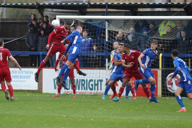 Action from Chippenham Town's (blue) goalless draw at home to Welling United. PICTURE: RICHARD CHAPPELL