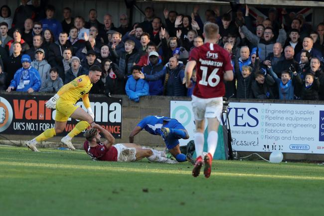 Action from the 3-0 defeat for Chippenham Town at home to Northampton Town in the FA Cup on Sunday. PICTURE: RICHARD CHAPPELL