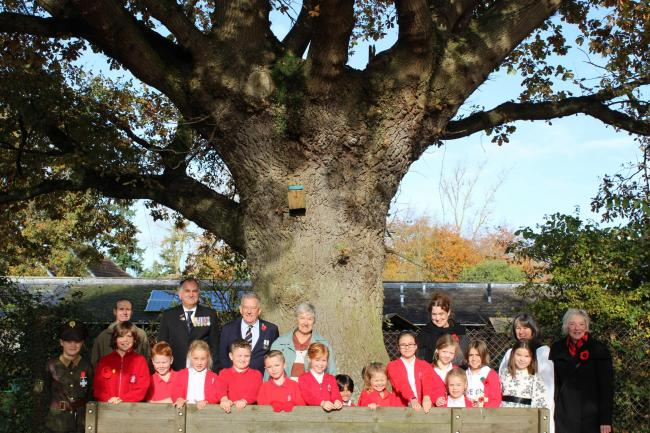 Children from Derry Hill Primary School at the dedication of their oak tree