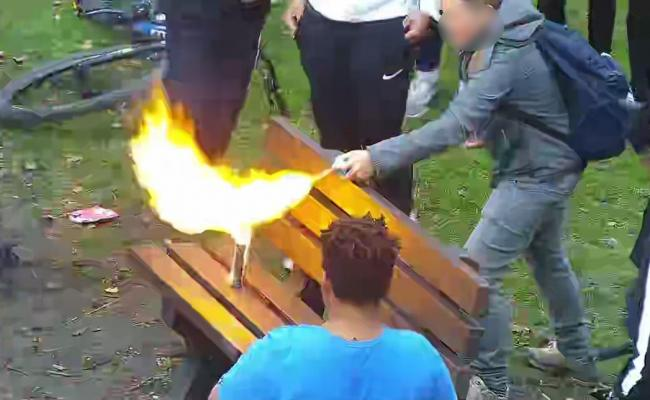 This photo shows the shocking moment when a young hooligan set fire to an aerosol can