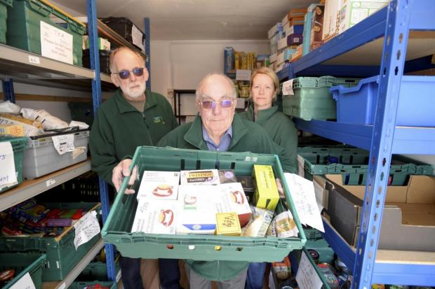 Ray Sanderson, centre, chairman of the Malmesbury and District Foodbank, with trustee's Dick Gray and Lisa Johns at the foodbank. Picture by Paul Nicholls