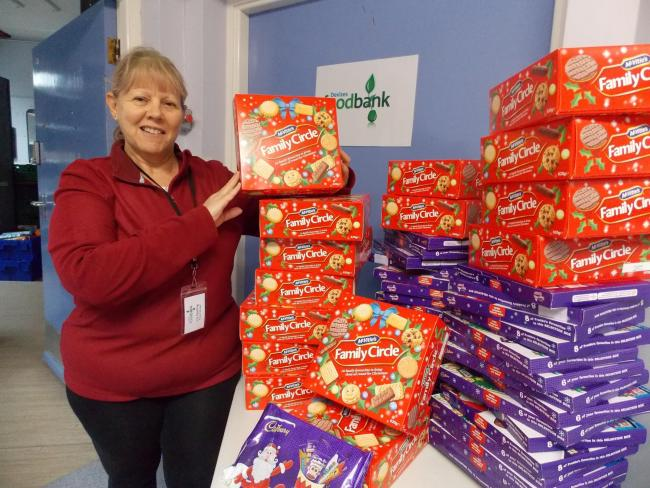 Devizes and District Foodbank manager Liz Starling with festive sweets and biscuits donated by The Finlay Foundation