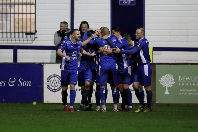 The Chippenham Town players celebrate a goal against Chelmsford City. PICTURE: RICHARD CHAPPELL