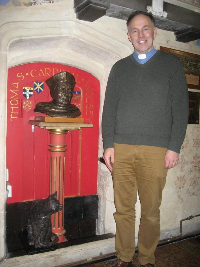 Rev Chris Smith and the newly revealed Wolsey bronze.
