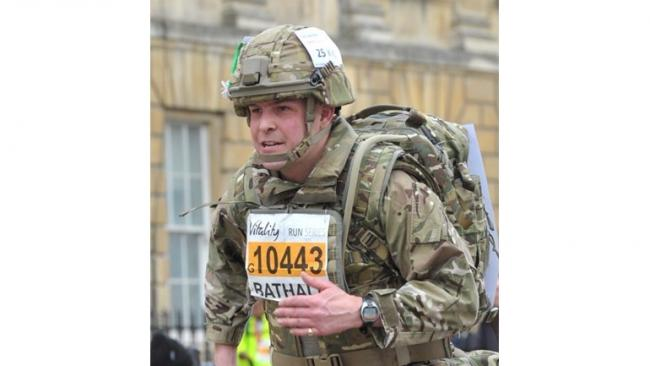 Amyas Godfrey in combat assault gear when he took part in Bath Half Marathon