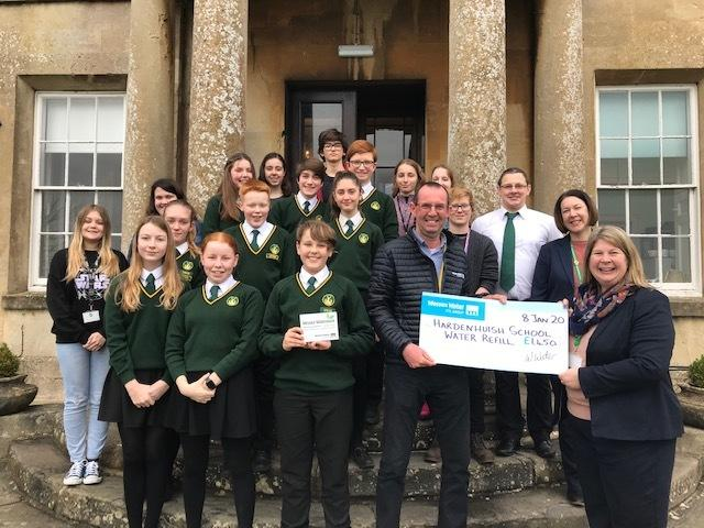 Wessex Water presenting the cheque to Hardenhuish headteacher Lisa Percy to help fund the school's new water fountain project