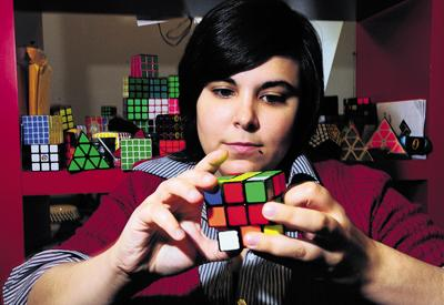 Student Charlotte Cooper lets her fingers do the talking as she makes light work of solving the Rubik's Cube puzzle