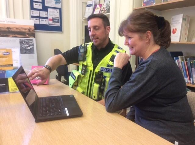 Sgt Kevin Harmsworth with Debbie Russon at Westbury Library