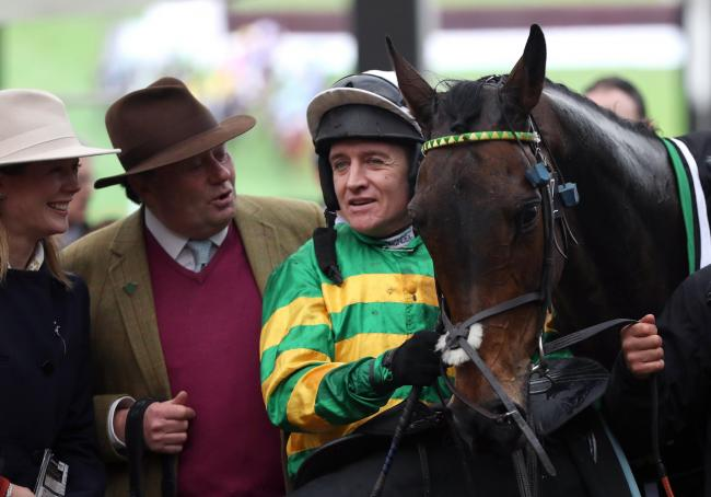 Barry Geraghty alongside Epatante and trainer Nicky Henderson following their victory in the Unibet Champion Hurdle Challenge Trophy on day one of the Cheltenham Festival at Cheltenham Racecourse, Cheltenham..
