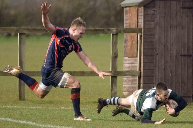 Matt Strong races in to grab Dorset & Wilts' second try of their win over Hampshire                                              Picture: Idris Martin