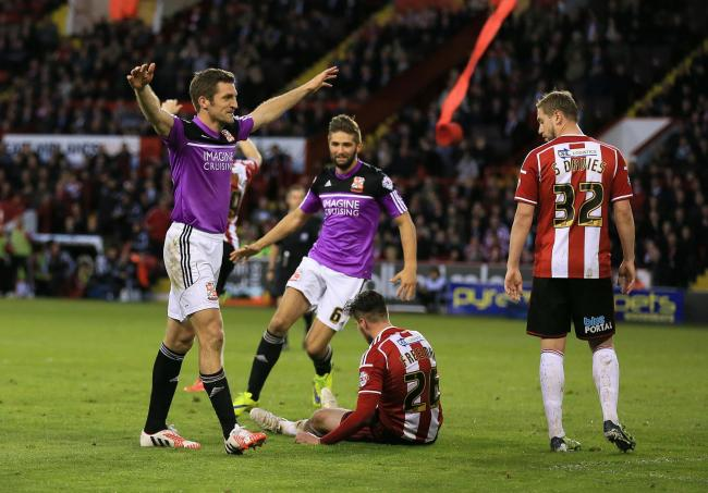 Swindon Town's Sam Ricketts (left) celebrates scoring his sides first goal of the game against Sheffield United during the Sky Bet League One, Play-Off Semi Final, First Leg at Bramall Lane, Sheffield..