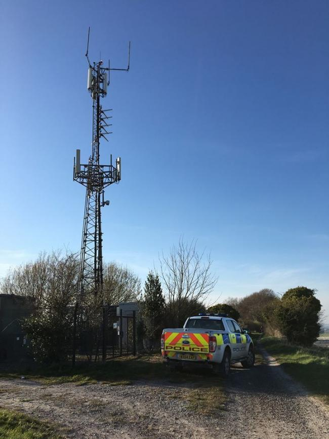 Police were called to this phone mast in Lavington after reports four people had climbed it