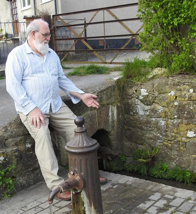 Bob Berry by the pump at the polluted stream
