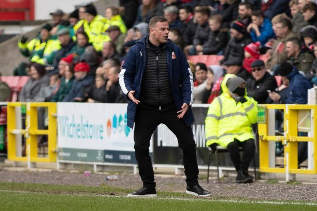 Swindon Town manager Richie Wellens on the touchline at the County Ground
