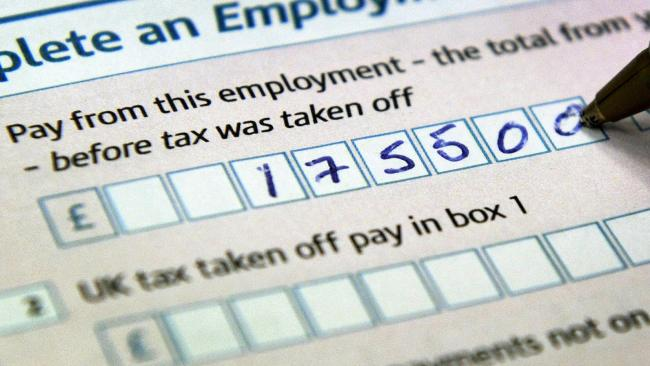 Close-up view of a person filling out a Self Assessment form to the amount of 175,500. Chancellor Alistair Darling today announced that from next April, those earning above 150,000 will pay a new tax rate of 50%.