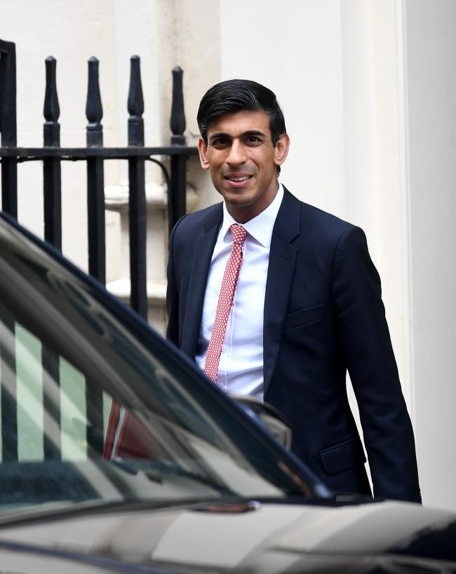 LONDON, ENGLAND - MARCH 16: Chancellor of the Exchequer, Rishi Sunak leaves Downing Street on March 16, 2020 in London, England. The Prime Minister announced that the UK is entering the delay phase of emergency planning. (Photo by Peter Summers/Getty Imag