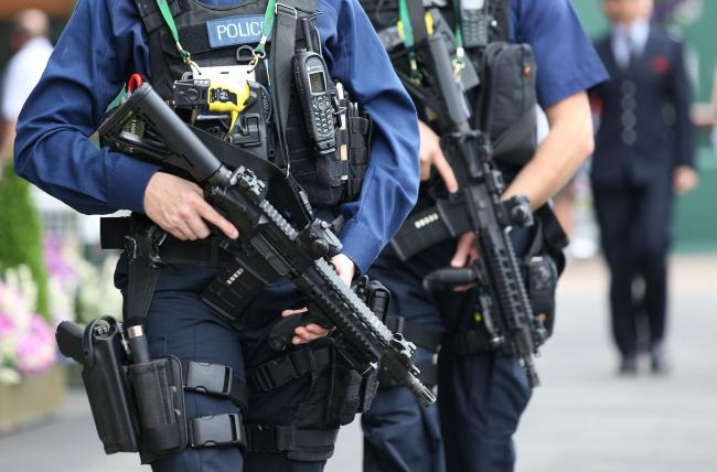 Armed police on patrol near centre court on day five of the Wimbledon Championships at the All England Lawn Tennis and Croquet Club, Wimbledon.