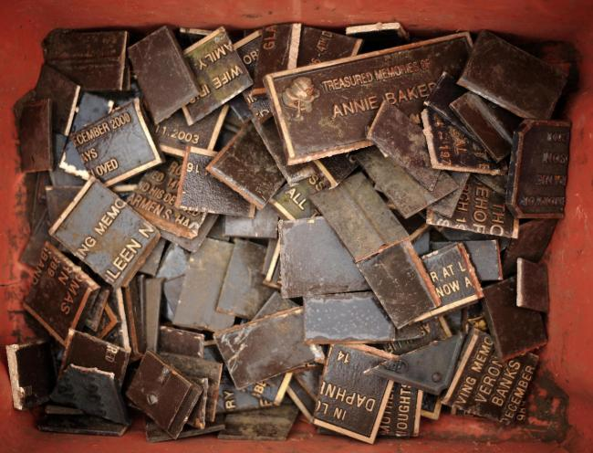 A general view of metal seized by police including memorial plaques, displayed at Croydon police station, London.