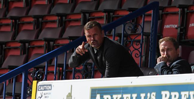 Swindon manager Richie Wellens directs operations from the stand during the match between  Swindon Town and Charlton Athletic  at The County Ground Stadium , Swindon, England on Saturday the 5th of September 2020. Carabao Cup, League Cup, Round one, Photo