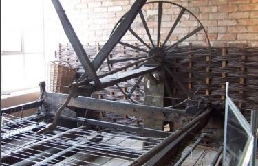 The turning handle and wheel of the Trowbridge Museum spinning jenny
