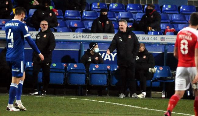 Swindon Town manager John Sheridan watched on as his side beat Ipswich Town 3-2 thanks to goals from midfielder, Scott Twine and winger, Diallang Jaiyesimi 	        Photo: Dave Evans