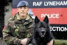 Corporal Damian Heartford with RAF Air Dog Kubo at their base, RAF Lyneham