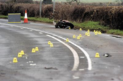 Police investigation markers at the scene of the accident yesterday morning