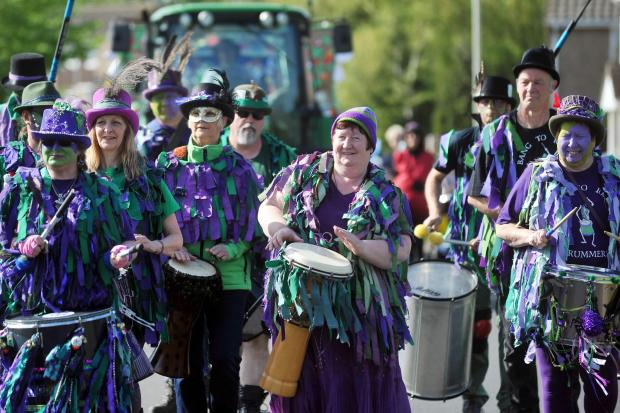 The Wiltshire Gazette and Herald: People playing drums at Wootton Bassett Carnival