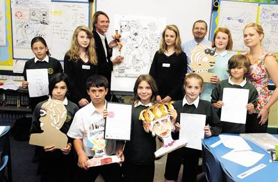 Back row, from left, Danni, Lucy, Kev Sutherland, Charlie, Mark Rackham, Harvi and Jenny Wiseman with, front, from left, Eve, Harri, Emily, Abi and Elliot celebrate St Peter's award of the Artsmark