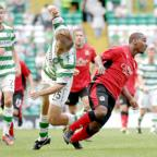BHOYED UP: Junior Hoilett shows his strength to see off Celtic's Milan Misun at Parkhead