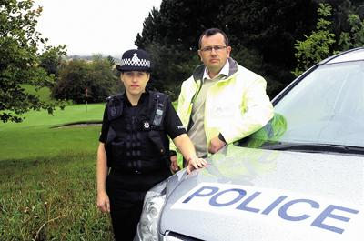 PC Emma Reed and Nigel Stokes near the 13th green of the golf club     (32608/20/PM)