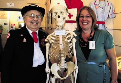 Red Cross stalwart Ivy Ward and new curator Melissa Barnett with Len the skeleton