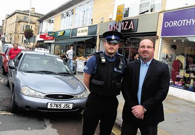 PCSO Ali Duncan and councillor Peter Hutton at the taxi rank at The Bridge