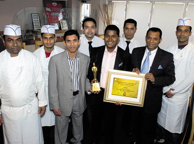 Staff at the Indian Spice of Bengal with their trophy are, from left, Mo Cheragali, Ashraful Islam, Gias Uddin, Rohan Islam, Hassan Uddin, Dulal Barua, Ala Uddin, Ismail Ali