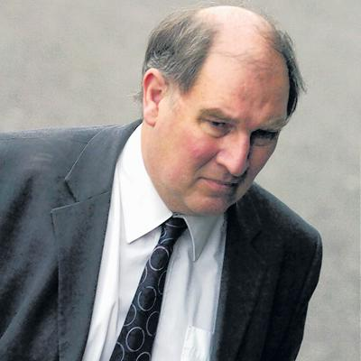 Coun Philip Brown arrives at Swindon to admit one charge of fraud and three of theft