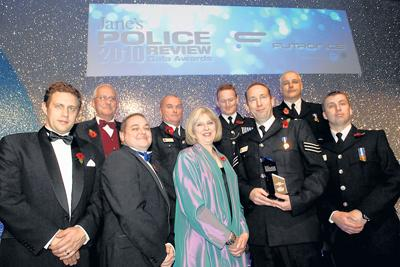 Back from left, PC Graham Hurst, PC Steve Porter, Brian Moore, Sgt Martin Alvis; front from left Janes Review team member, PCSO Andy Singfield, Home Secretary Theresa May, Sgt Dave Stevenson, Insp Steve Cox