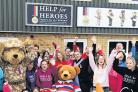 Charity founders Bryn and Emma Parry celebrate the Wiltshire Times' success with helpers