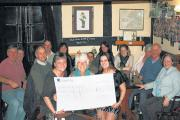 Landlady Julie Elliot, left, and daughter Alex Elliot, right, give a cheque to Help for Heroes volunteer Liz Bailey